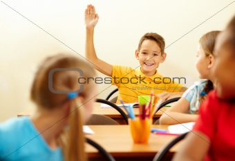 Boy raising arm