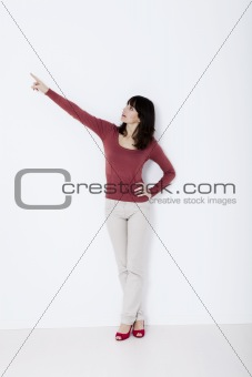 Beautiful woman standing and pointing