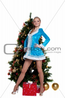 Young Snow Maiden stand with new year fir tree