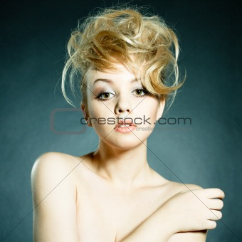 Fashion portrait of beautiful young woman posing on black backgr