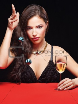 woman holding dices on red table