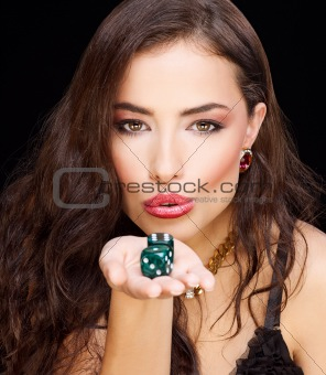 woman holding dices on black background