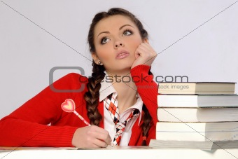 College girl with pile of books