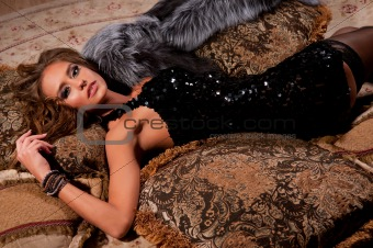 woman lying on a fur mat