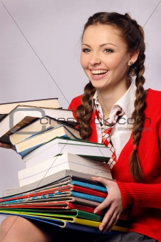 Young girl laughing catches books