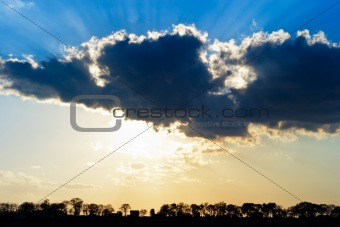 Sun Rays Beam through Dark Ominous Clouds