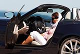 Young lady sitting in cabriolet