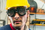 Closeup of an industrial worker in yellow helmet