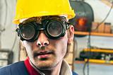 Closeup of an industrial worker in yellow helmet