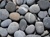 Grey pebbles on the beach 