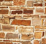 Abstract old colorful stone wall as background
