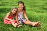Two happy little girls having fun in the summer day
