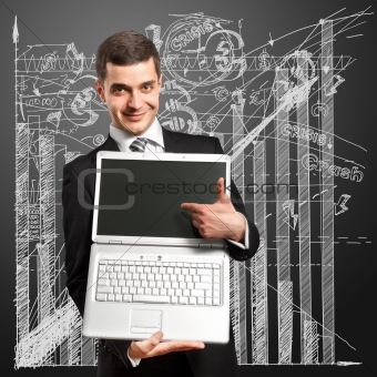 Businessman With Open Laptop In His Hands