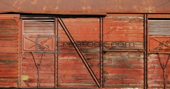 Covered goods wagon side as background
