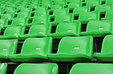 Green Empty plastic seats at stadium