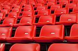 Red Empty plastic seats at stadium