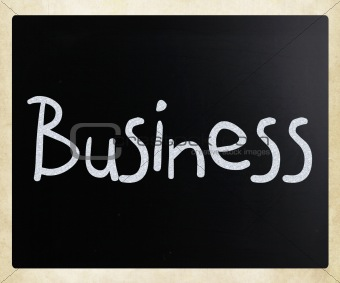 "The word ""Business"" handwritten with white chalk on a blackboard"