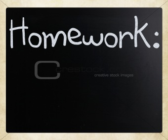 """Homework"" handwritten with white chalk on a blackboard"