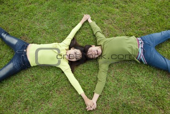 happy  asian couple lying on the grass