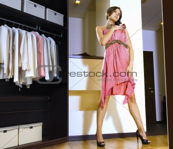woman fits on a dress