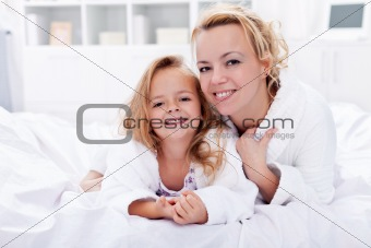 Woman and little girl after bath