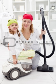 Cleaning day - woman and little girl with vacuum cleaner