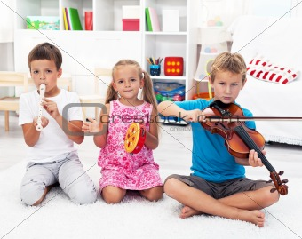 Kids playing on musical instruments