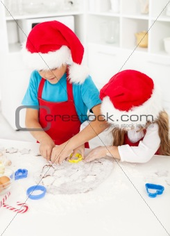 Kids making christmas cookies