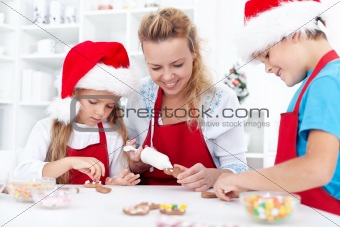 Family decorating christmas cookies