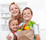 Happy family with the groceries