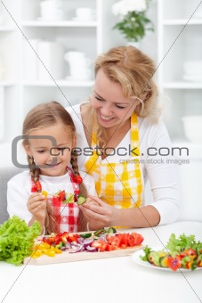 Mother and child preparing food