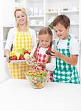 Kids preparing a healthy fresh salad
