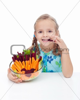 Little girl holding bowl of vegetables