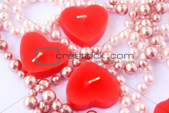 Red candles and necklace