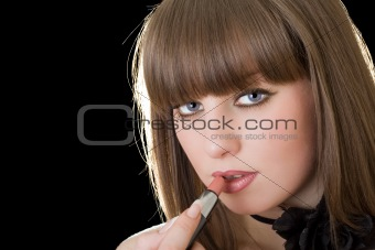 Portrait of the pretty girl with lipstick