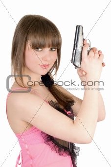 Beautiful girl in a pink dress with pistol