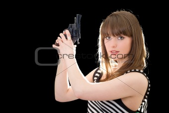 Beautiful young woman with pistol. Isolated on black