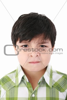 Portrait of beautiful little boy with serious look isolated on w