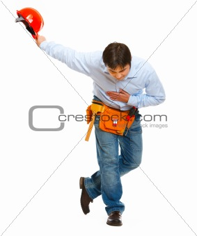 Construction worker bowing with helmet in hand