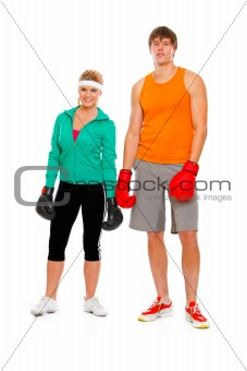 Portrait of fit young woman and man in boxing gloves isolated on white