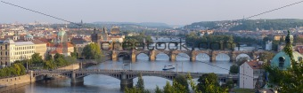 Sunrise over Prague. Panorama of five bridges.