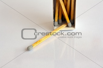 Gray head matches with box on white background