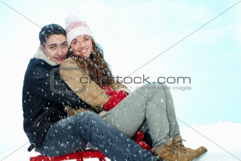Couple on sledge