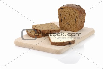 sliced rye bread with sandwich on a chopping board isolated on w