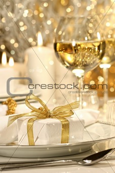 Gold ribboned gift with gold background