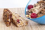 Granola bowl and bars with raspberries