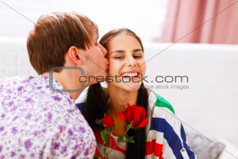 Happy girl get rose as present from her boyfriend