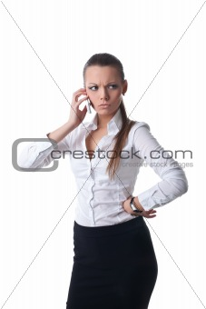 Sexy young serious business woman talk on phone