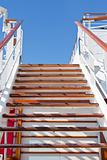 wooden steps and blue sky