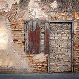 Old wall with immured window